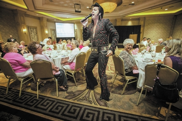Elvis impersonator Brendan Paul performs during Pink Paper Day Celebrity Breakfast at the Suncoast hotel-casino on Wednesday. The event, sponsored by the Las Vegas Review-Journal, kicked off Breas ...