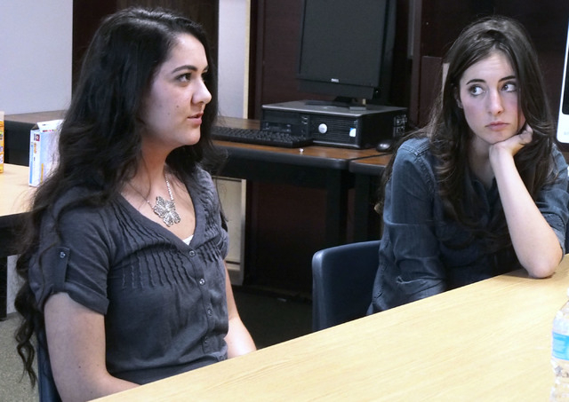 Madison Santoli, right, listens intently as Micheline Ghanem talks about her experiences in high school during a USA Network public service announcement recording session on bullying at West Caree ...