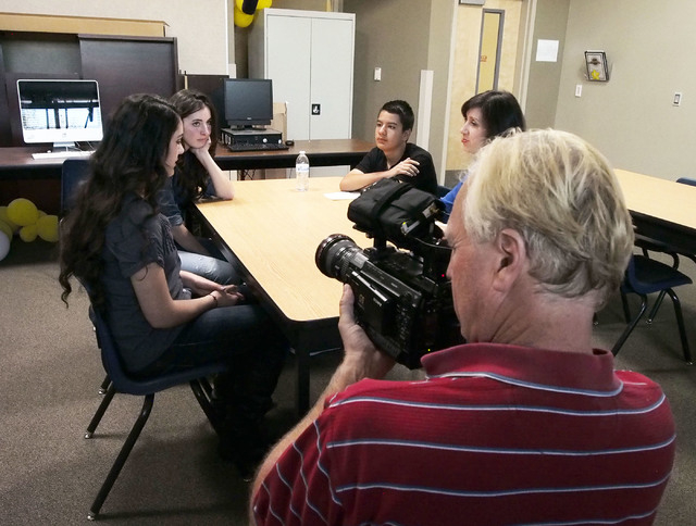 Darryl Nelson video records students Micheline Ghanem, Madison Santoli and Juan Garcia, left to right, and Kate Tellers, senior producer at The Moth in New York, during a USA Network public servic ...