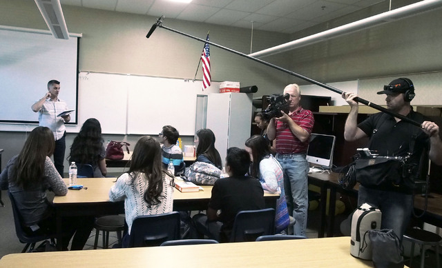 Wade Guice, at rear, explains procedures to a group of students during a USA Network public service announcement recording session on bullying at West Career and Techincal Academy in Las Vegas, Tu ...