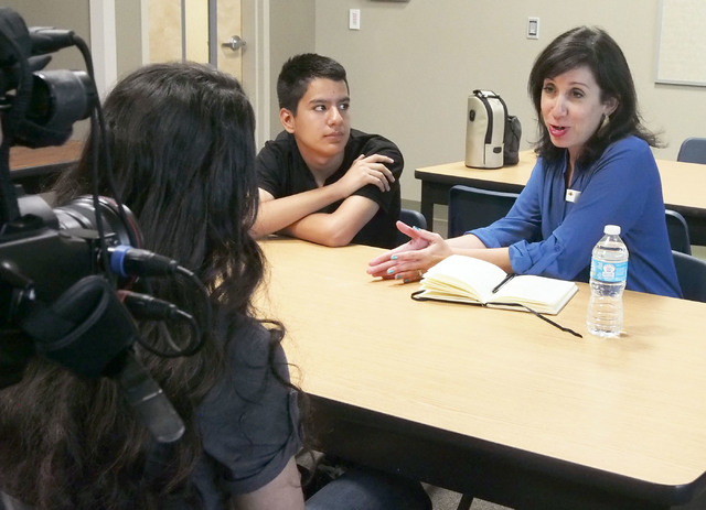 Kate Tellers, senior producer at The Moth in New York, right, discusses presentation techniques with Micheline Ghanem, left, during a USA Network public service announcement recording session on b ...
