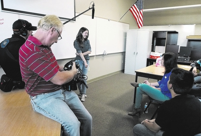 Darryl Nelson records Madison Santoli as she speaks about her battle with anorexia during a USA Network public service announcement recording session on bullying at West Career and Techincal Acade ...