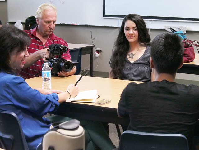 Darryl Nelson records Juan Garcia, right, during a USA Network public service announcement recording session on bullying at West Career and Techincal Academy in Las Vegas, Tuesday, Oct. 8, 2013. W ...