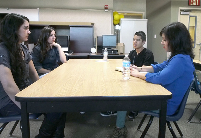 Kate Tellers, senior producer at The Moth in New York, right, discusses presentation techniques with, from left, Micheline Ghanem, Madison Santoli and Juan Garcia during a USA Network public servi ...