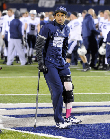 Utah State quarterback Chuckie Keeton walks off the field after the Aggies lost to BYU 31-14, Friday, Oct. 4, 2013, in Logan, Utah. Keeton is the starting quarterback for Utah State and injured hi ...