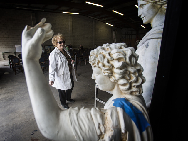 Lois Berkowitz views statues for sale Thursday in a warehouse at the Rio. Caesars Entertainment will auction 14,000 items for four days starting Friday at the Rio. (Jeff Scheid/Las Vegas Review-Jo ...