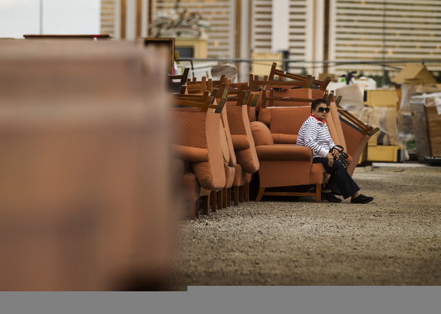 A woman who declined to give her name sits on a chair Thursday outside warehouse at the Rio. Caesars Entertainment will auction 14,000 items for four days starting Friday. (Jeff Scheid/Las Vegas R ...