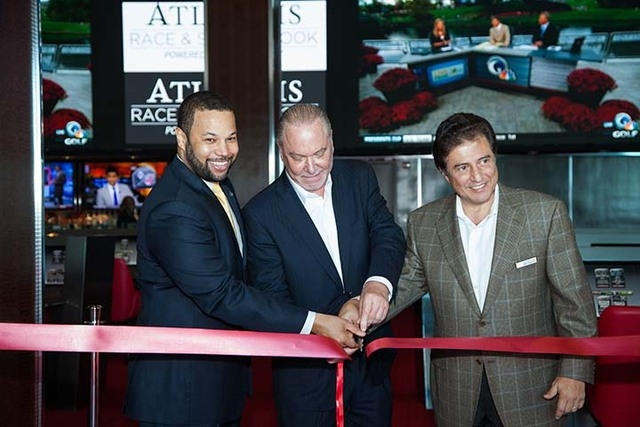 Dr. Andre Rollins, chairman of the Gaming Board, Lee Amaitis, (center) president & CEO of Cantor Gaming and George Markantonis, president/managing director of Atlantis, Paradise Island cut the rib ...