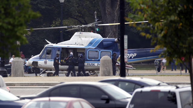 A U.S. Park Police helicopter is loaded with a victim from a shooting on the Mall in Washington on Thursday.  (AP Photo/Alex Brandon)
