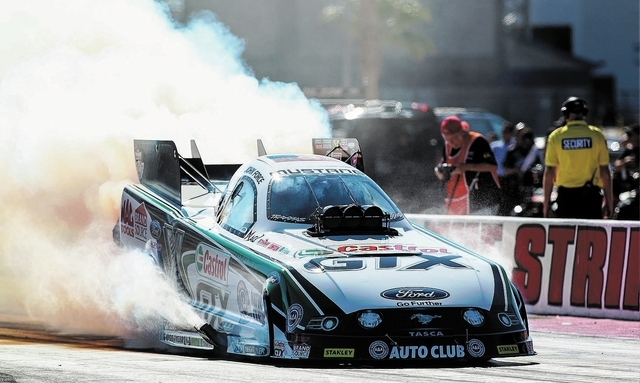 John Force does a burnout before the funny car qualifying heat during the NHRA Toyota Nationals at The Strip at the Las Vegas Motor Speedway on Saturday, Oct. 26, 2013. (Chase Stevens/Las Vegas Re ...