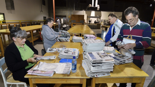Geri Hutt, left, folds newspapers with, from right, her sons Bill Ryan and Jamie Hutt and her daughter Patty Hutt at a Las Vegas Review-Journal distribution warehouse at 1110 Mary Crest Road in He ...