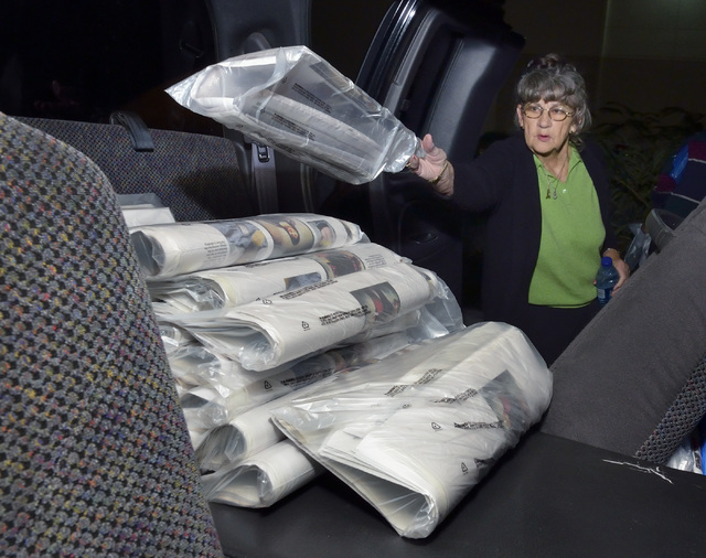 Geri Hutt loads her pickup truck with newspapers at a Las Vegas Review-Journal distribution warehouse at 1110 Mary Crest Road in Henderson before delivering them on Thursday, Oct. 10, 2013. Hutt,  ...