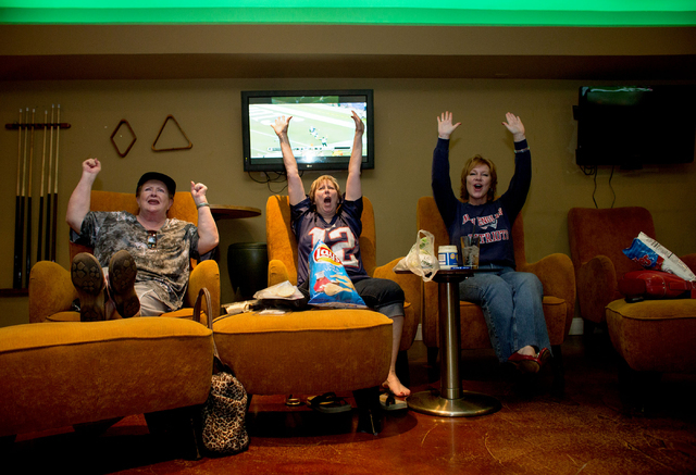 From left, Corinne Anderson, Joy Ruby and Wendy Valvo celebrate as the Patriots score a touchdown against the Jets Sept. 12 at The Cavalier Lounge, 3850 E. Desert Inn Road. The trio said they have ...