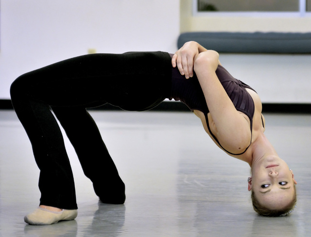 """Hannah Schiller of the Nevada Ballet Theatre forms an arch during a rehearsal for """"A Choreographers' Showcase."""" (Bill Hughes/Las Vegas Review-Journal)"""