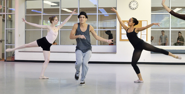 """Michelle Meltzer, left, Ariel Triunfo, right, both of Nevada Ballet Theatre, and Greg Pennes of """"Mystere"""" rehearse for """"A Choreographers' Showcase,"""" a collaboration between Nevada Ballet Theatre a ..."""