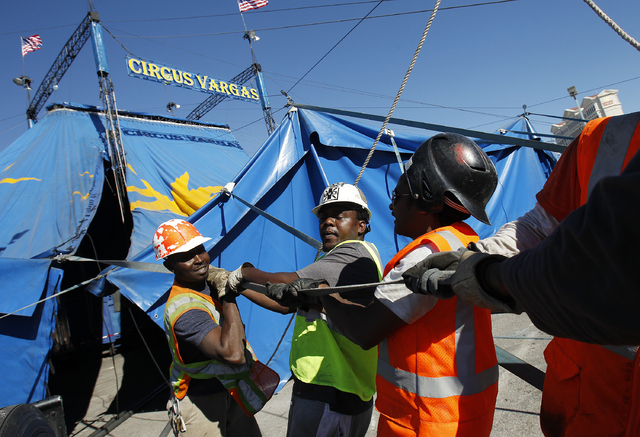 From left, Michael Kisao, Shida Nguwa and Peter Munga help erect a circus tent for Circus Vargas at The Rio in Las Vegas Tuesday, Oct. 22, 2013. The circus will hold shows in the tent in the Rio p ...