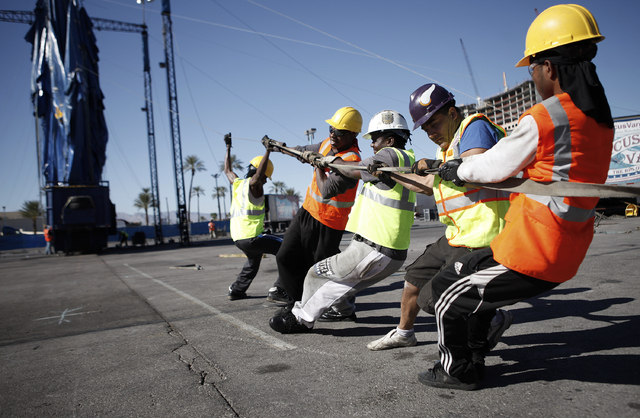 Workers help erect a circus tent for Circus Vargas at The Rio in Las Vegas Tuesday, Oct. 22, 2013. The circus will hold shows in the tent in the Rio parking lot October 24 thru Oct. 27. (John Loch ...