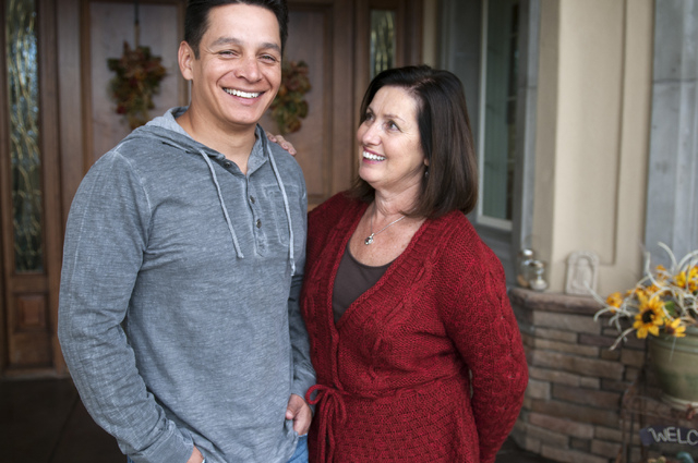 Walter Trujillo, a Venezuelan national and legal United States resident, and his partner Christina Cesaretti, pose for a photo at their home in Las Vegas, Nev., Thursday, Oct. 10, 2013. The Nevada ...