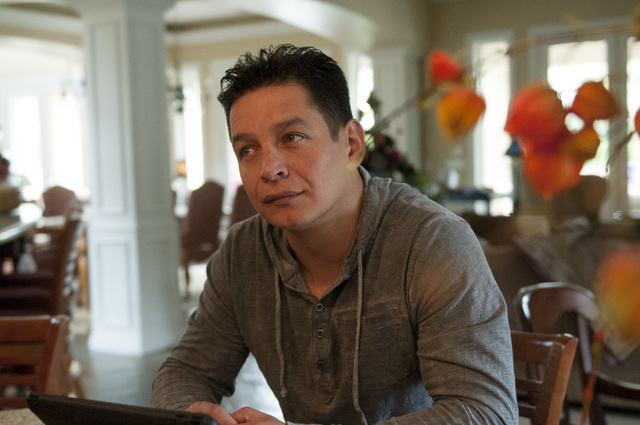Walter Trujillo, a Venezuelan national and legal United States resident, looks at his partner Christina Cesaretti as she talks about his legal immigration case at their home in Las Vegas, Nev., Th ...