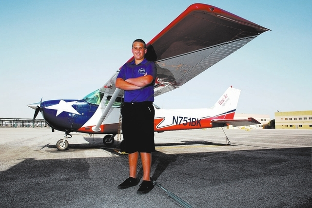 Andrew Aldrich, 16, poses with a Cessna 172 airplane at the North Las Vegas Airport on Wednesday, Sept. 25, 2013. Aldrich, a junior at Centennial High School, flew the plane solo before getting hi ...