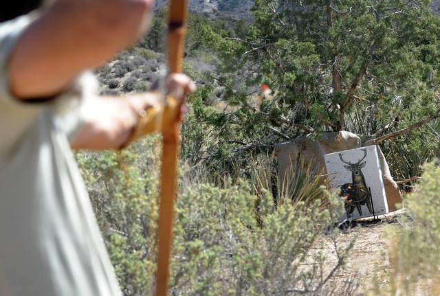 "Spring Mountain Free Trapper layne ""Eeore"" Hofhine  shoots with a bow & arrow at a target during weekend competition at the Lovell Wash in Lovell Canyon on Saturday, Oct. 5, 2013. The Fr ..."
