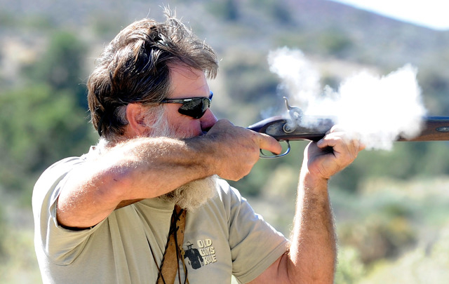"Spring Mountain Free Trapper layne ""Eeore"" Hofhine  shoots at a target during weekend shoot competition at the Lovell Wash in Lovell Canyon on Saturday, Oct. 5, 2013. The Free Trappers a ..."