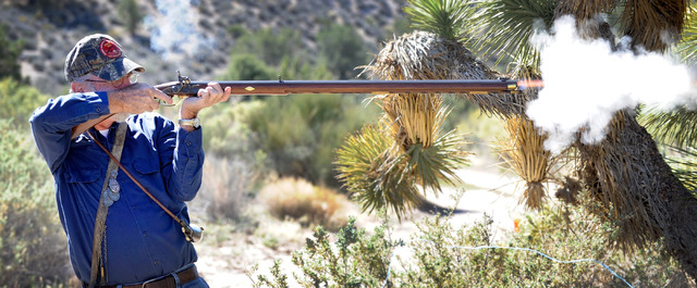 "Spring Mountain Free Trapper Larry ""Lightfoot"" Schlickenmayer shoots at a target during weekend shoot competition at the Lovell Wash in Lovell Canyon on Saturday, Oct. 5, 2013. The Free Trappers a ..."