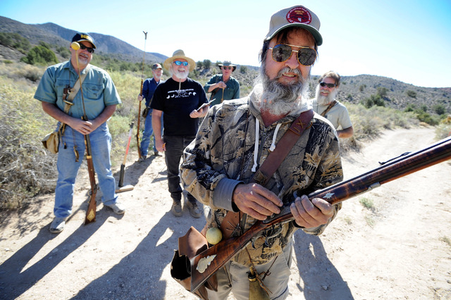 "Spring Mountain Free Trapper Dan ""Buffalo Rump"" Trousdale readies his rifle before shooting during a weekend competition in Lovell Canyon on Saturday, Oct. 5, 2013. The Free Trappers are ..."