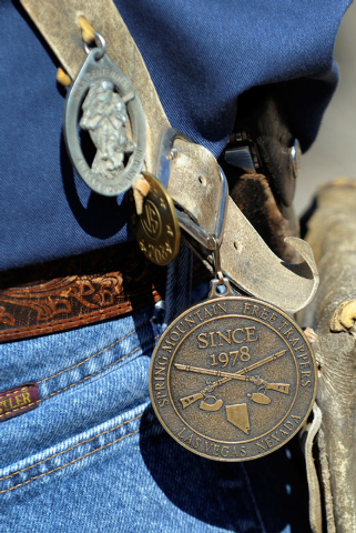 "Medals and trinkets hang from Spring Mountain Free Trapper Larry ""Lightfoot"" Schlickenmayer side-pouch during a weekend competition in Lovell Canyon on Saturday, Oct. 5, 2013. The Free T ..."