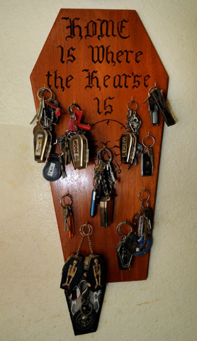 """In the Schoening's distinctive Pahrump home they even have a coffin-shaped key rack. The sign reads: """"Home is where the hearse is."""" (David Becker/Las Vegas Review-Journal)"""