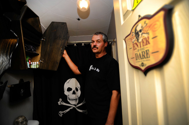 Bryan Schoening's displays a coffin-shaped storage cabinet in a bathroom at his Pahrump home, Coffinwood. (David Becker/Las Vegas Review-Journal)
