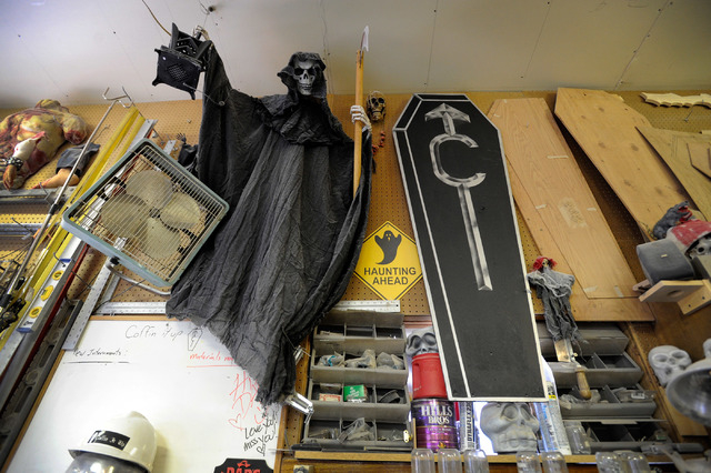 The angel of death looks down in Bryan Schoening's workshop at his Pahrump home, Coffinwood. Bryan and his wife, Dusty, have making a living designing and selling coffins from their home. (David B ...