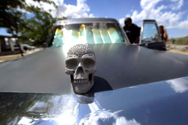 A skull hood ornament is displayed on one of Bryan and Dusty Schoening's 11 restored classic hearses. This way they can carry their theme beyond their home and along the streets of Pahrump. (Dav ...