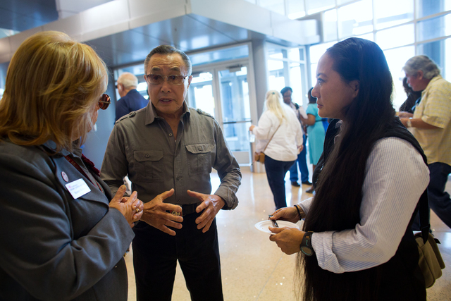 National Atomic Testing Museum curator, Karen Green, left, former Army paratrooper Al Tseu (cq), center and Tseu's daughter, Lianne Duffy (cq), talk before the National Day of Remembrance for nucl ...
