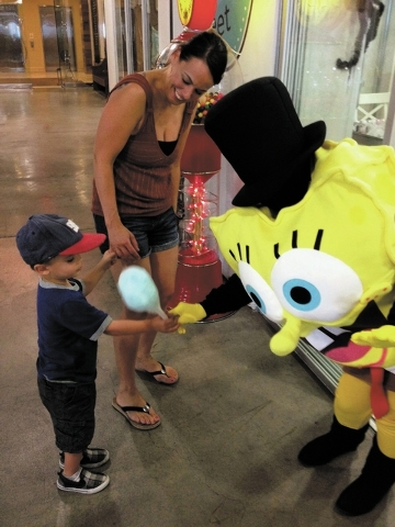 Bodhi Spano receives fresh cotton candy from SpongeBob Squarepants as his mother, Misty Spano, watches at B Sweet Candy Boutique in the Market LV at Tivoli Village, 302 S. Rampart Blvd., Sept. 22. ...