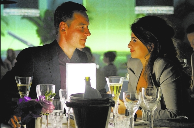 """The Counselor"" (Michael Fassbender) and his girlfriend, Laura (Penelope Cruz), enjoy a romantic evening. (Twentieth Century Fox Film Corporation)"