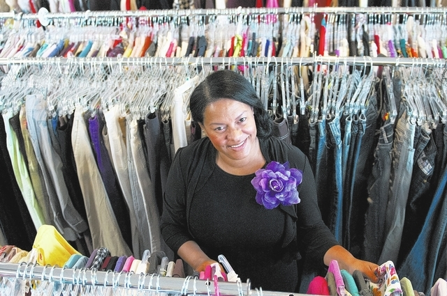 Rebeca Ferreira works in the now-closed Survivor Store and Training Center, which was part of her nonprofit, Safe Faith United. The group helps victims and survivors of domestic violence. (Erik Ve ...