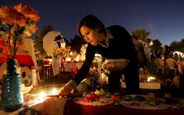 Claudia Sanchez lights candles on an altar called an ofrenda during a Dia de Los Muertos festival outside the Winchester Cultural Center, 3130 S. McLeod Drive, Nov. 1, 2007. This year's Day of the ...