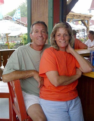 """This undated photo provided by Patty Konietzky, shows her with husband Henry """"Butch"""" Konietsky after tubing in Helen, Ga. Butch died 60 hours after contracting the bacteria vibrio vulnif ..."""