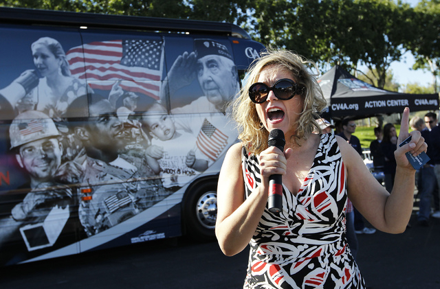 Jessie Jane Duff, U.S. Marine Corps Gunnery Sergeant (Ret.), speaks on behalf of Concerned Veterans for America to a crowd gathered at Bike Fest at the Cashman Center in Las Vegas on Oct. 4, 2013. ...