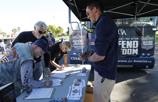Concerned Veterans for America encourages people to sign a petition calling for Veterans Affairs to expediate disability claims at Bike Fest at the Cashman Center in Las Vegas on Oct. 4, 2013. The ...