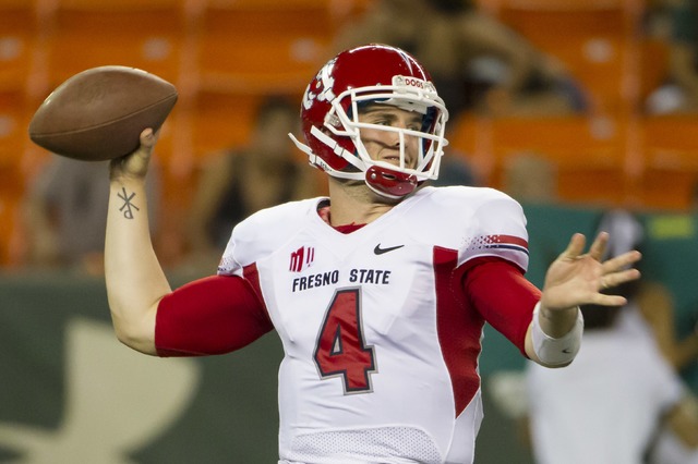 Fresno State quarterback Derek Carr throws a pass in a game against the University of Hawaii on Sept. 28 in Honolulu. (AP Photo/Eugene Tanner)