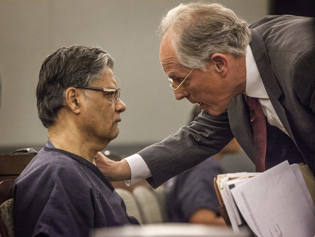 Defense attorney Richard Wright, right, talks to Dr. Dipak Desai during sentencing Thursday, Oct. 24, 2013 at Regional Justice Center. Desai was sentenced  to life in prison with the possibility o ...