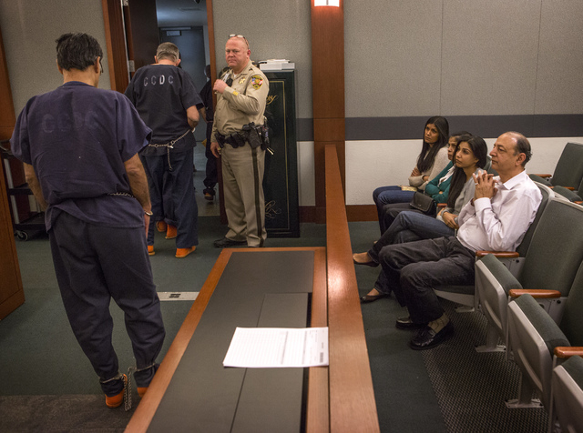 A shackled Dr.  Dipak Desai leave  District Judge Valerie Adair courtroom while his family sits after his sentencing Thursday, Oct. 24, 2013  at Regional Justice Center. Desai was sentenced  to li ...