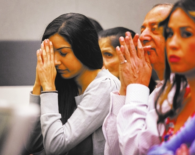 Dr.  Dipak Desai's family acknowledges him while he is escorted in to District Judge Valerie Adair courtroom for sentencing Thursday, Oct. 24, 2013  at Regional Justice Center. Desai was sentenced ...