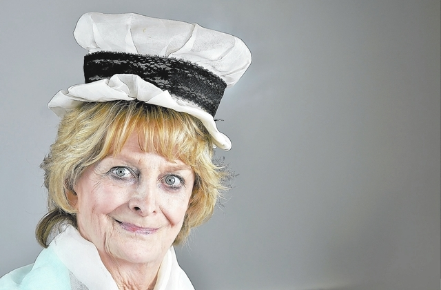 Maureen Matteson Kane, a nursing historian and emeritus faculty member of the University of Nevada, Las Vegas School of Nursing, wears a nurse's cap and scarf that she believes dates back to the l ...