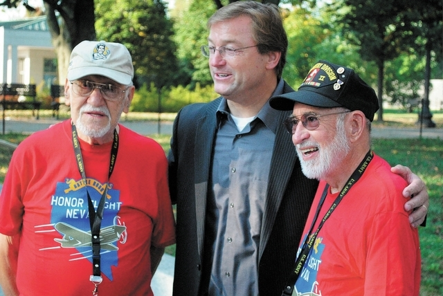 Vincent Moleta, 90, left, and Tom Krawkowiak, 87, pose Saturday at the entry of the World War II Memorial with Sen. Dean Heller, R-Nev. The two Reno veterans traveled to Washington with Honor Flig ...