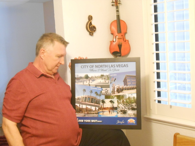 New York West drummer Brian Thomas holds a photo collage of North Las Vegas parks meant to accompany the jingle he wrote to mark the opening of Craig Ranch Regional Park. Thomas, pictured Oct. 1 a ...
