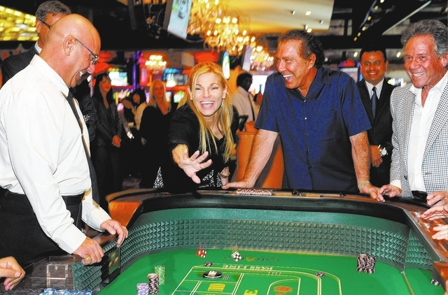 Andrea Wynn throws out the first dice after her husband, Steve Wynn, placed the first bet on the opening day of the Downtown Grand Las Vegas hotel-casino on Sunday, Oct. 27, 2013. (David Becker/La ...