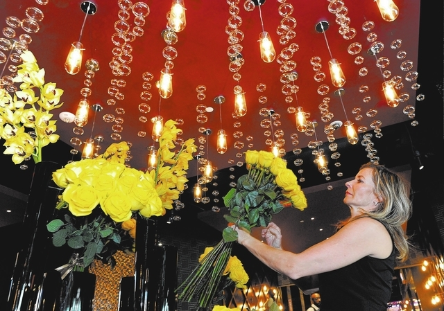 Florist Erika Varga makes the last minute preparations to the hotel lobby before the opening of the Downtown Grand Las Vegas hotel-casino on Sunday, Oct. 27, 2013. (David Becker/Las Vegas Review-J ...